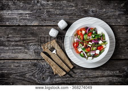 Greek Salad With Grilled Asparagus, Cherry Tomatoes, Cucumbers, Black Olives, Red Onion Rings With O
