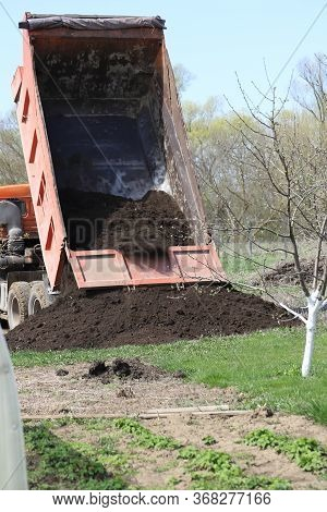 Moscow Region Russia-may 2020: The Dump Truck Brought The Land And Empties It, The Dump Truck Unload