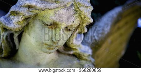 Ancient Stone Statue Of  Wonderful Angel With Sweet Facial Expression. Horizontal Image.
