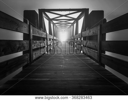 Eerie Image Of An Old Truss Footbridge On A Dark Foggy Morning At Tims Ford State Park.