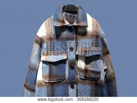 Wool Blend Collared Overshirt With Long Sleeves And Pockets On Hanger Isolated On Blue Background. C