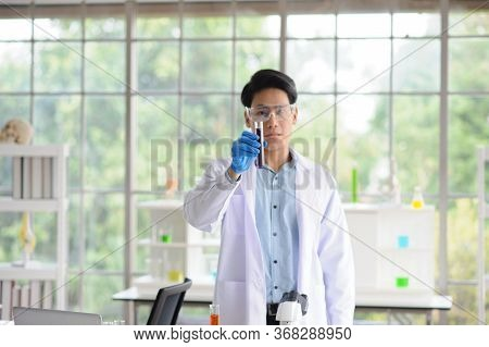 Doctor Holding Blood Sample Tubes For Study Research And Research In Order To Produce Therapeutic Wo