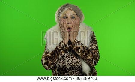 Elderly Style Granny Caucasian Mature Woman Expresses Shock, Looks Surprised On Chroma Key Backgroun