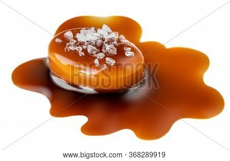 Caramel Sauce Flowing Over Salted Caramel Candies, Isolated On White Background. Golden Butterscotch