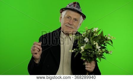 Elderly Stylish Grandfather Caucasian Mature Man With Bouquet Of Flowers And An Engagement Ring On C