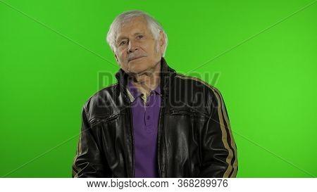 Elderly Stylish Grandfather Caucasian Rocker And Biker Mature Man On Chroma Key Background. Old Seni