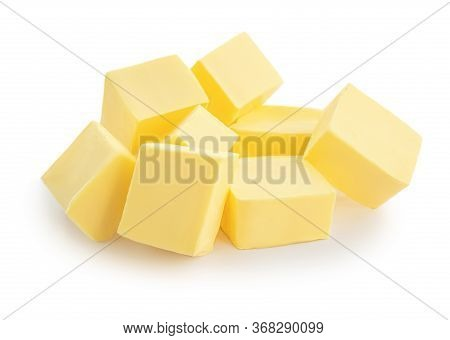 Pieces Of Butter Isolated On White Background. Fresh Butter  Cubes Top View