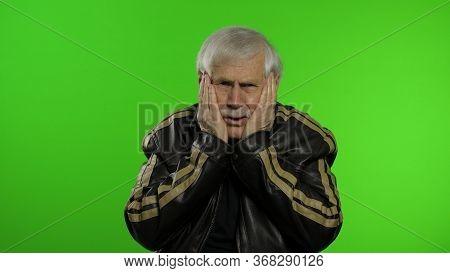 Elderly Stylish Grandfather Caucasian Rocker And Biker Mature Man Expresses Shock, Looks Surprised O