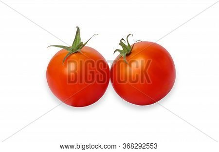 Two Red Tomatoes Isolated On The White Background. Cherry Tomato Is A Small That Has A Sweet, Firm T