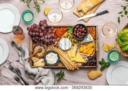 Cheese Platter For Summer Outdoor Party, Top Down View Of Rustic Table Setting With Various Kinds Of