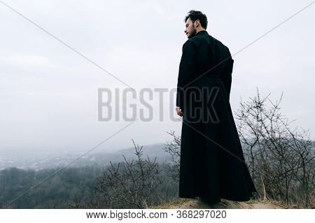 Portrait Of A Young Priest, Father With A Beard And Mustache. Religion Christianity And Catholicism