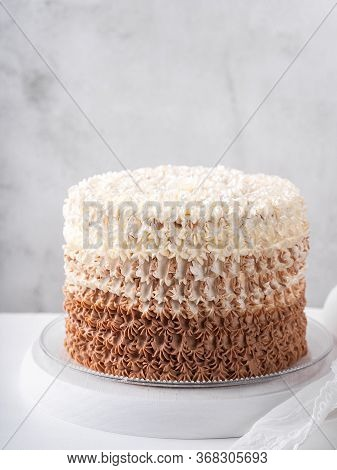 Birthday Buttercream Chocolate Cake On Vintage White Table Behind Light Wall Background, Copy Space.
