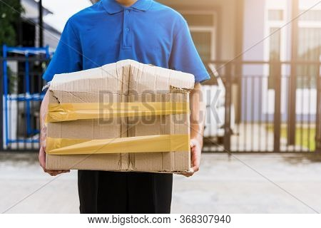 Asian Young Delivery Man In Blue Uniform He Emotional Falling Courier Hold Damaged Cardboard Box Is