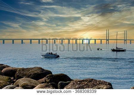 Sunset Over The Oresund Bridge Connecting Sweden With Denmark