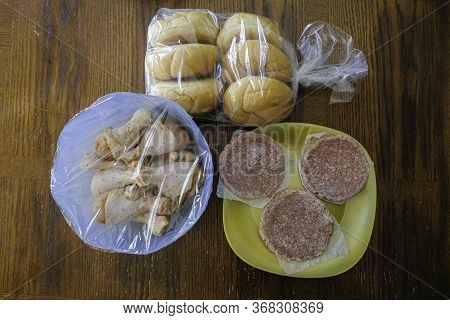 Frozen Raw Beef Burger Patties Prepared For Barbeque Grill Cookout