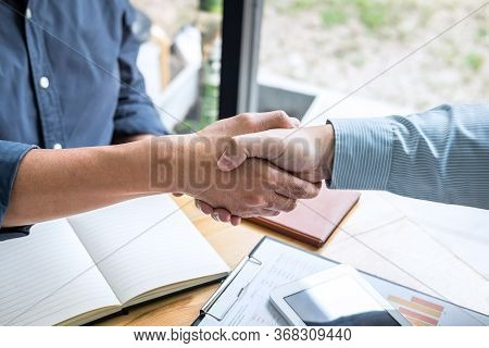 Successful Of Business Deal, Business Partnership Meeting And Handshake After Discussing Good Deal A