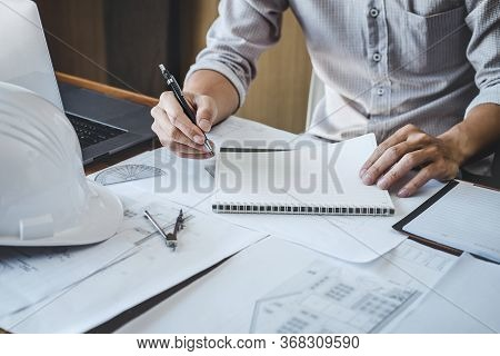 Construction And Structure Concept Of Engineer Or Architect Working On Blueprint, Engineer Working W