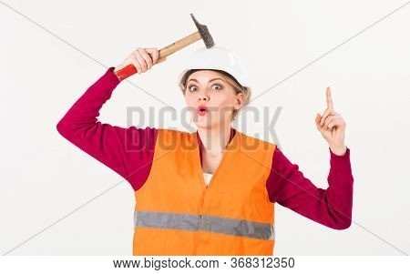 Woman With Surprised Face Knocks With Hammer On Head,