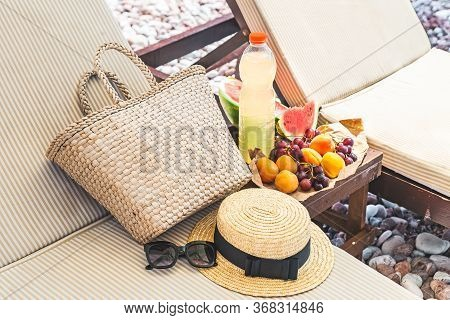 Picnic At The Beach. Fresh Fruits On The Table Near Sun Loungers