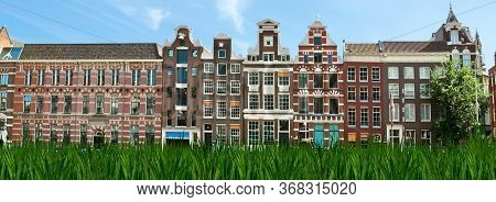 View Of Amsterdam City And Typical Dutch Houses