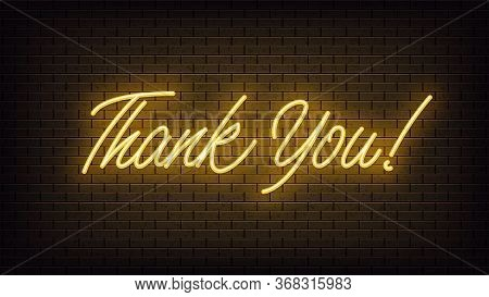 Yellow Neon Thank You, Lettering. Neon Text Of Thank You On Black Brick Background. Night Vivid Ligh
