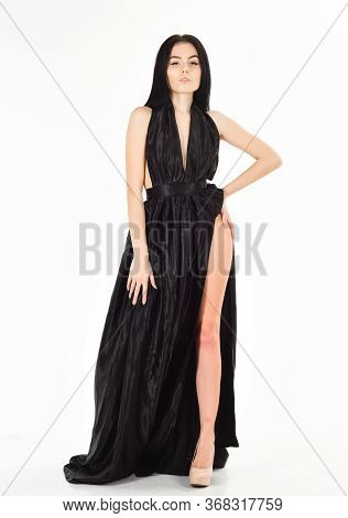 Lady, Sexy Girl In Dress. Attractive Girl Wears Expensive Fashionable Evening Dress With Erotic Slit