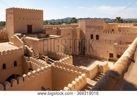 View Over Nizwa Fort With It's Many Walls And Battlements, Oman