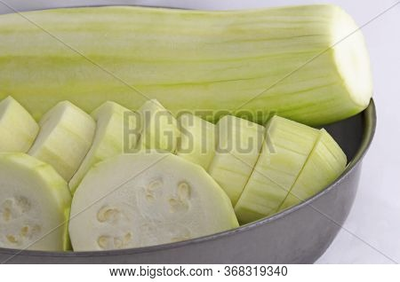 Slices Of Fresh Raw Zucchini, Courgette, Cucurbita  Or Squash Vegetable Marrow In Bowl, Sofia, Bulga