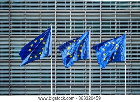 European EU flags in front of the Berlaymont building, headquarters of the European commission in Brussels