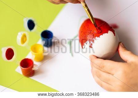 Happy Easter. Little Girl Painter Painted Eggs. Kid Preparing For Easter. Painted Hand. Finger Paint