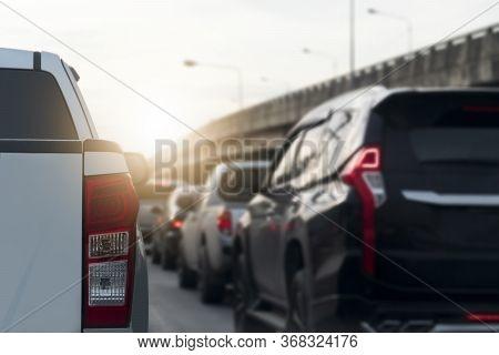 Luxury Rear Corner Of Pickup Silver Bronze Car On The Road With Open Brake Light.  Traffic Congestio