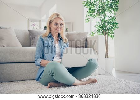 Photo Of Attractive Middle Aged Domestic Lady Relaxing Sitting Comfy Floor Carpet Near Couch Browsin