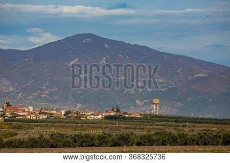 Hazy Midday Hot Daytime Landscape From Far Away With Haze Of Village Of Nea Kessani, Xanthi Region,