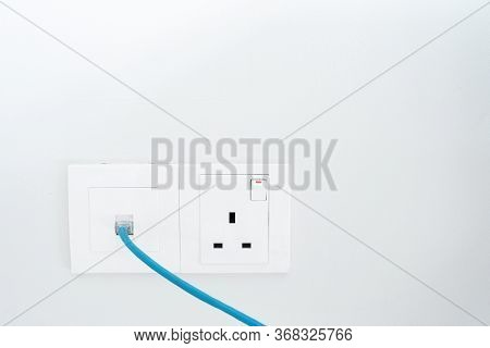 Power Socket And Internet Socket. Socket Malaysian Type. Socket With Switch On A White Wall
