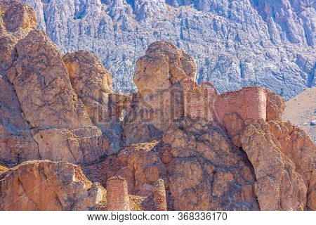 Stone Castle On The Rocks. Ancient Fortress In The Mountains. Massive Red Stone Boulders. The Fortre