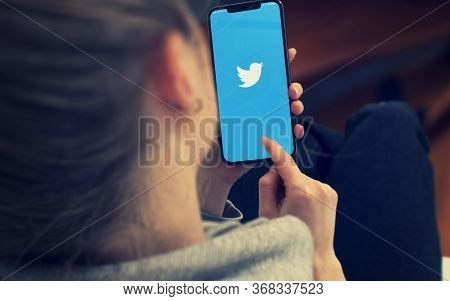 Kyiv, Ukraine-january, 2020: Twitter On Smartphone Screen. Young Girl Pointing Or Texting Twitter On