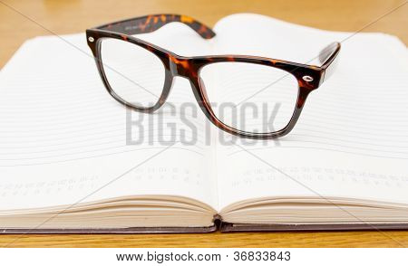 Glasses On Open Empty Book