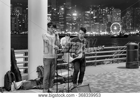 Hong Kong / China - July 25, 2015: Young Street Musicians Performing In Tsim Sha Tsui Promenade Of K
