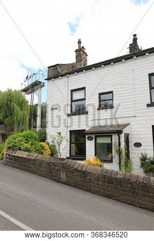 Oakworth, England - June 22:  Perks' House Beside Oakworth Station On The Keighley And Worth Valley