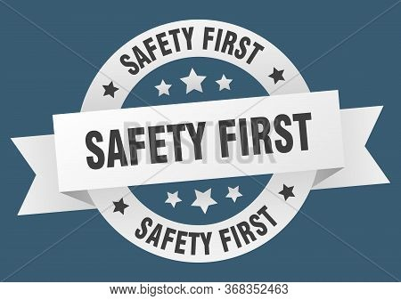 Safety First Ribbon. Safety First Round White Sign. Safety First