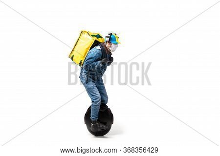 Too Much Orders. Contacless Delivery Service During Quarantine. Man Delivers Food Wearing Gloves And