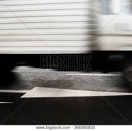 Movement On The Road. Moving Truck. Blurred Motion.