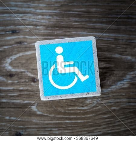 A Blue Disabled Sign, Symbol Or Icon For Mentally Disabled And Physically Disabled People On A Woode