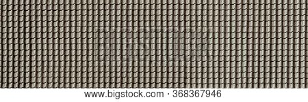 Dark Textured Roof From A Gray Ceramic Tile For Backgrounds And For Architecture Wallpaper.