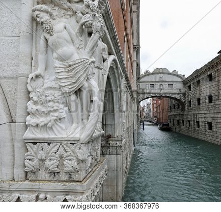 Statue Of The Doge's Palace In Venice And The Famous Bridge Of Sighs