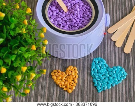 Wallpaper. Abstract Beautiful Backdrop. Granules For Hair Removal. Blue Wax Granules