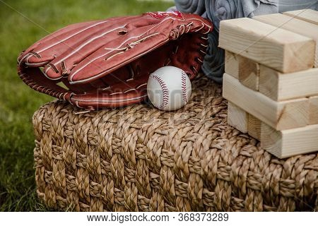 Baseball In A Glove In The Outfield. Baseball Mitt Glove With Ball.