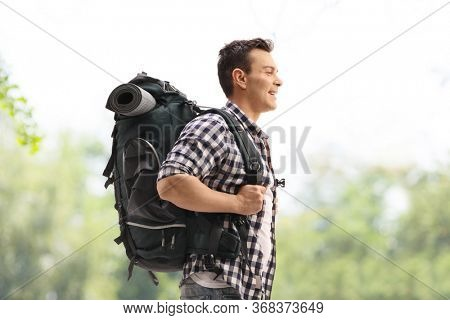 Young male hiker with a backpack outdoors