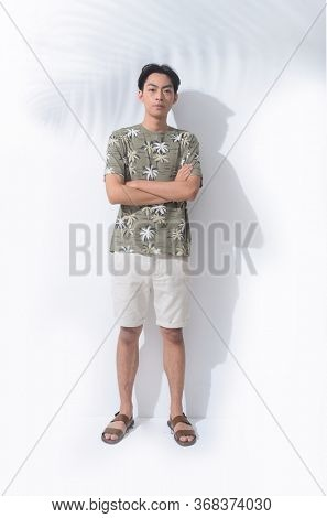 Full body Summer man casual wearing new stylish coconut tree printed t-shirt with white pants shorts and flip flop with shadow