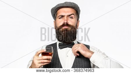 Bearded Man Wearing Suit And Drinking Whiskey, Brandy, Cognac. Bearded In Is Holding A Glass Of Whis